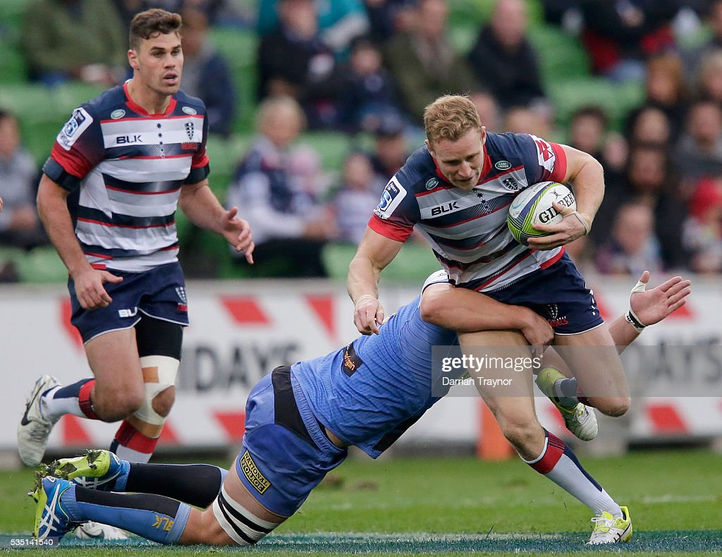 Reece Hodge of the Rebels runs with the ball during the round 14 Super Rugby match between the Rebels and the Force at AAMI Park on May 29, 2016 in Melbourne, Australia.