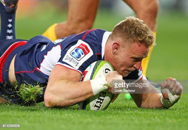 Reece Hodge of the Rebels scores a try during the round 17 Super Rugby match between the Melbourne Rebels and the Jaguares at AAMI Park on July 14...