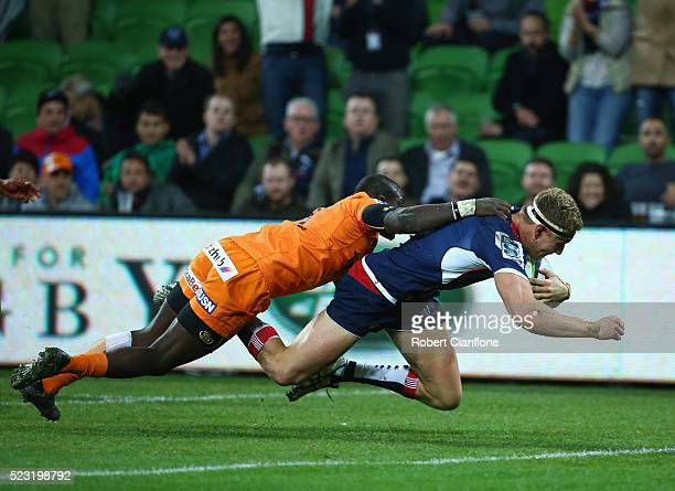 Reece Hodge of the Rebels scores a try during the round nine Super Rugby match between the Melbourne Rebels and the Cheetahs at AAMI Park on April 22...