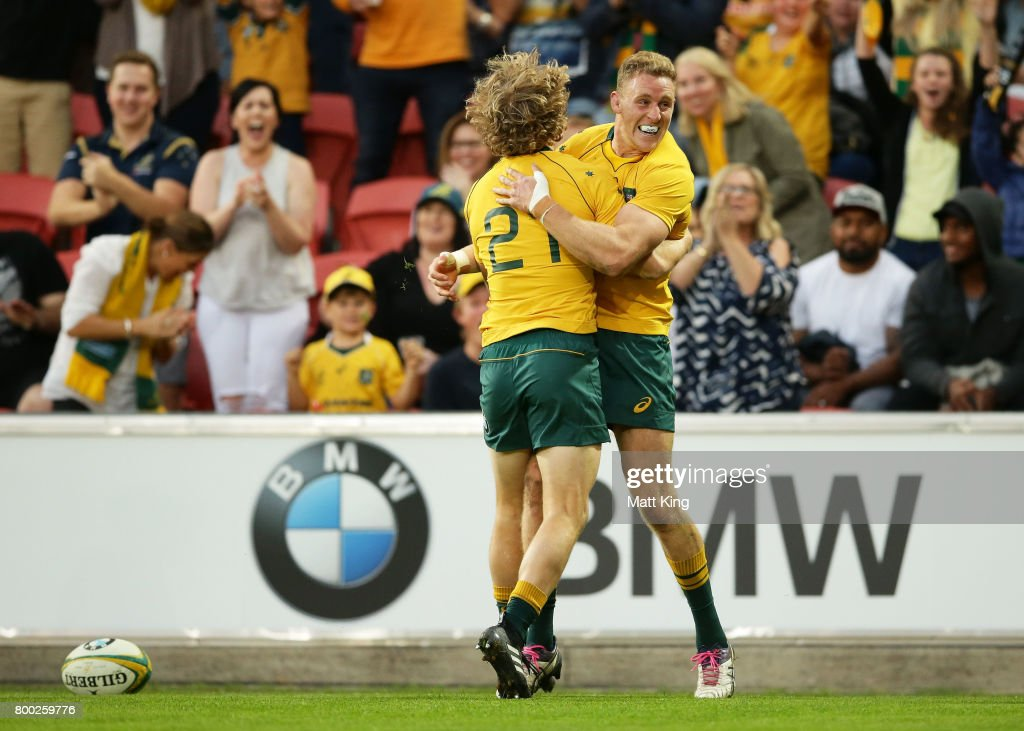 Reece Hodge of the Wallabies (R) celebrates with Joe Powell (L) afrter scoring a try during the International Test match between the Australian Wallabies and Italy at Suncorp Stadium on June 24, 2017 in Brisbane, Australia.