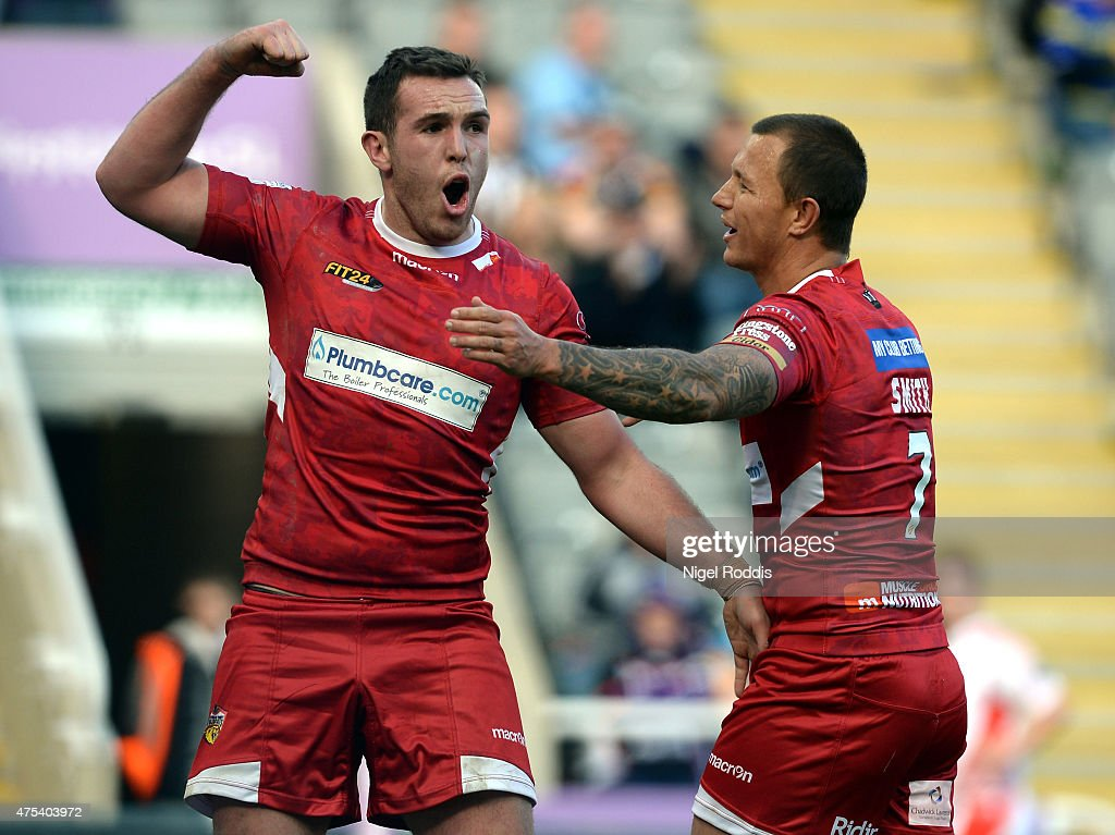 Reece Lyne (L) of Wakefield Trinity Wildcats celdebrates scoring a try with Tim Smith during the Super League match between Castleford Tigers and Wakefield Trinity Wildcats at St James' Park on May 31, 2015 in Newcastle upon Tyne, England.