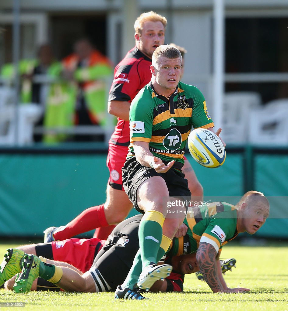 Reece Marshall of Northampton passes the ball uring the pre season friendly match between Northampton Saints and Moseley at Franklin's Gardens on August 23, 2014 in Northampton, England.