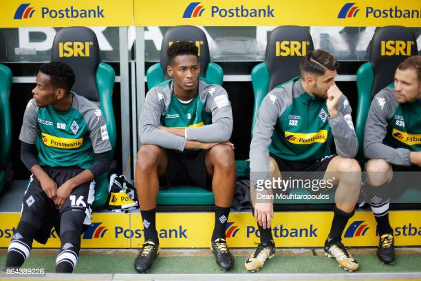 Reece Oxford of Borussia Monchengladbach looks on from the bench prior to the Bundesliga match between Borussia Moenchengladbach and Bayer 04...