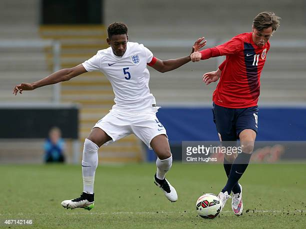 Reece Oxford of England and Andreas Helmersen of Norway battle for the ball during the U17 Euro Elite Qualifying Round match between England and...