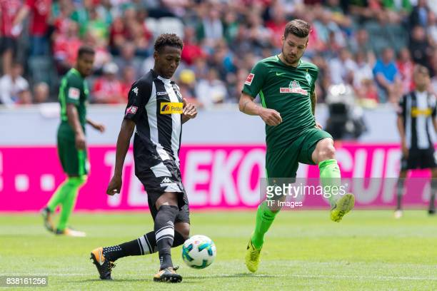 Reece Oxford of Gladbach and Jerome Gondorf of Bremen battle for the ball during the Telekom Cup 2017 match between Borussia Moenchengladbach and...