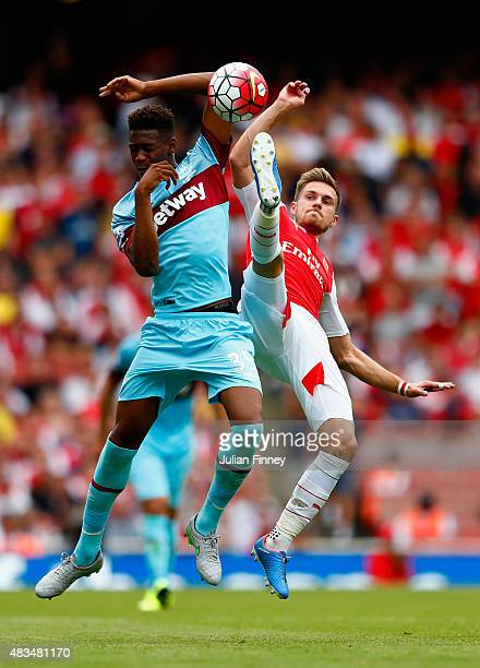 Reece Oxford of West Ham United and Aaron Ramsey of Arsenal battle for the ball during the Barclays Premier League match between Arsenal and West Ham...
