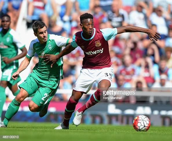 Reece Oxford of West Ham United is tackled by Fin Bartels of SV Werder Bremen during the Betway Cup match between West Ham Utd and SV Werder Bremen...