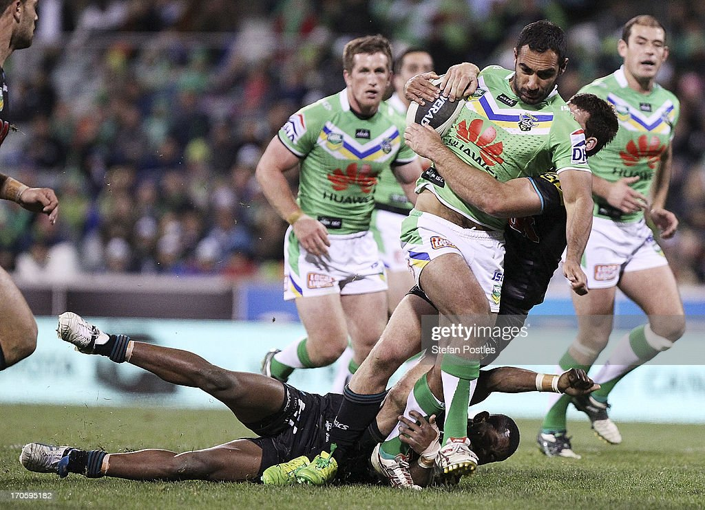 Reece Robinson of the Raiders is tackled during the round 14 NRL match between the Canberra Raiders and the Penrtih Panthers at Canberra Stadium on June 15, 2013 in Canberra, Australia.