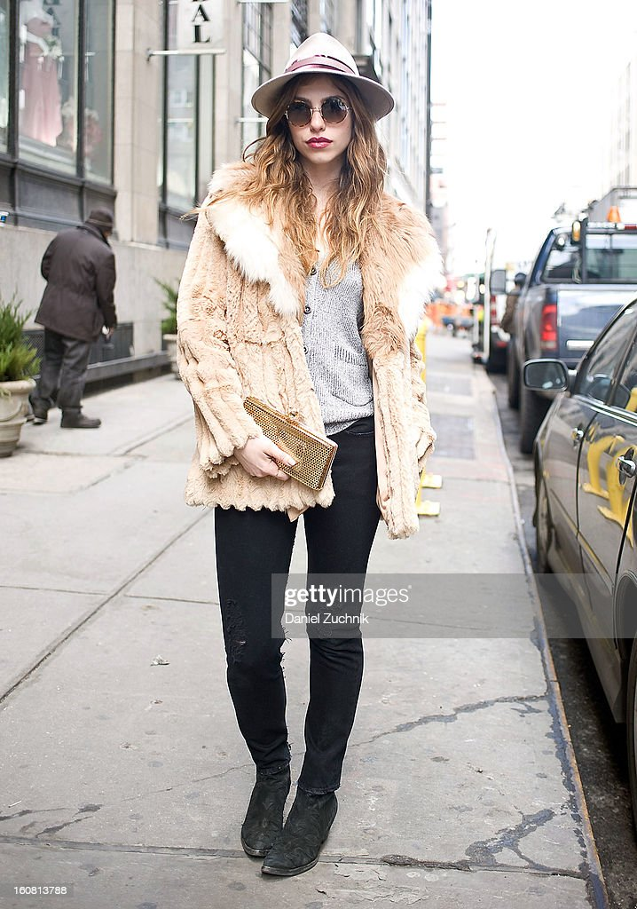 Reece Solomon, designer of Reece Hudson from New York, is seen outside the Patrick Ervell show wearing vintage fur, Levis jeans, Ralph Lauren sunglasses, Reece Hudson handbag and hat on February 6, 2013 in New York City.