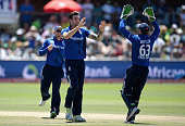 Reece Topley of England celebrates with England captain Eoin Morgan and Jos Buttler after dismissing JP Duminy of South Africa during the 2nd...