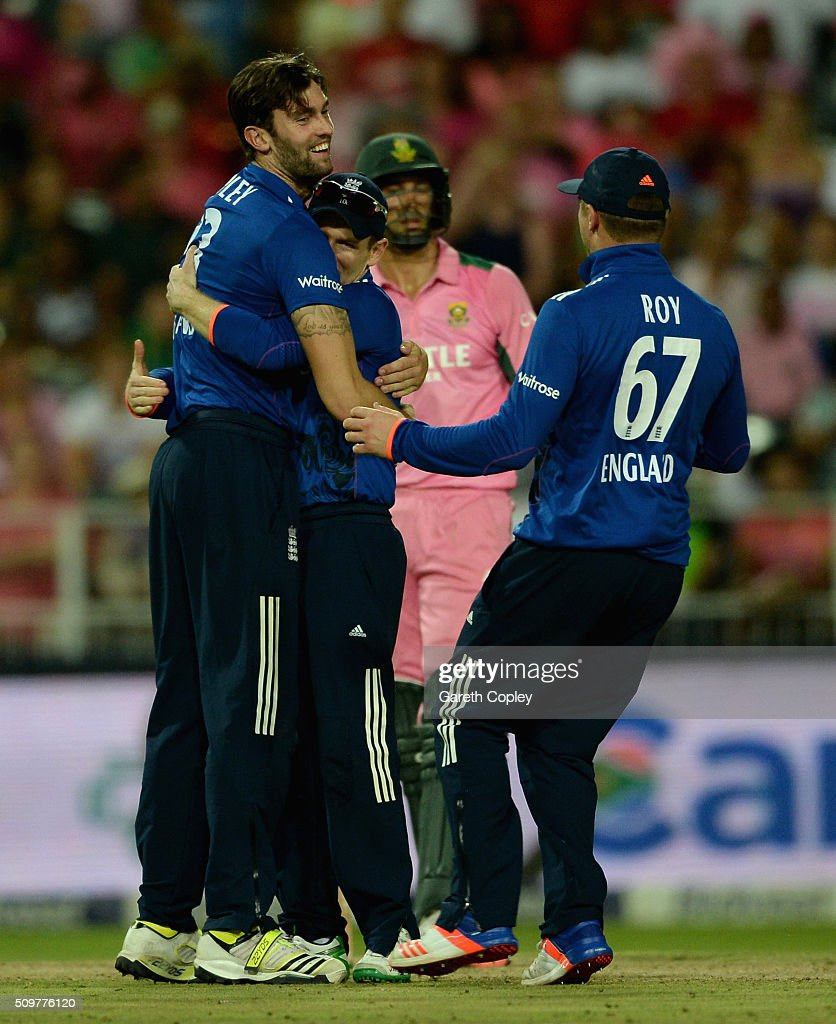 Reece Topley of England celebrates with England captain Eoin Morgan and Jason Roy after dismissing Farhaan Behardien of South Africa during the 4th Momentum ODI between South Africa and England at Bidvest Wanderers Stadium on February 12, 2016 in Johannesburg, South Africa.