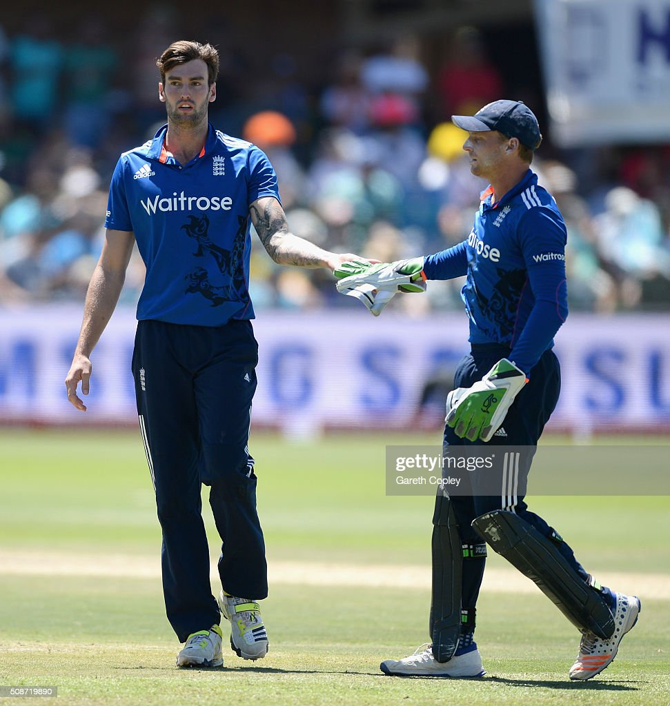 Reece Topley of England celebrates with Jos Buttler after dismissing Kagiso Rabada of South Africa during the 2nd Momentum ODI between South Africa and England at St George's Park on February 6, 2016 in Port Elizabeth, South Africa.