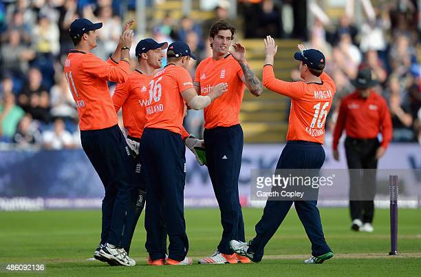 Reece Topley of England celebrates with teammates after dismissing Mitchell Marsh of Australia during the NatWest T20 International match between...