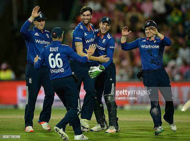 Reece Topley of England celebrates with teammates after dismissing Kagiso Rabada of South Africa during the 4th Momentum ODI between South Africa and...