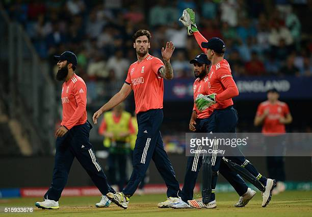 Reece Topley of England celebrates with teammates after dismissing Dwayne Bravo of the West Indies during the ICC World Twenty20 India 2016 Super 10s...