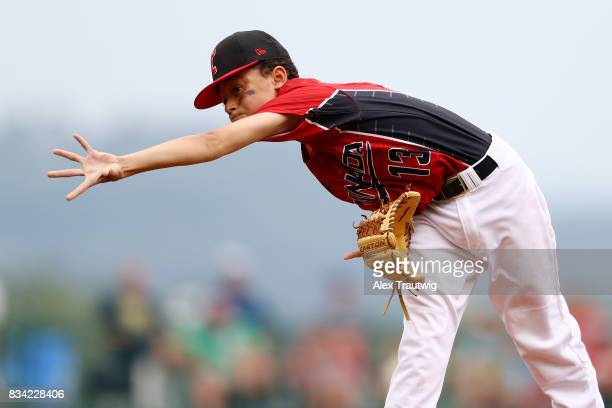 Reece Usselman of the Canada team from British Columbia runs home to score during Game 3 of the 2017 Little League World Series against the Europe...
