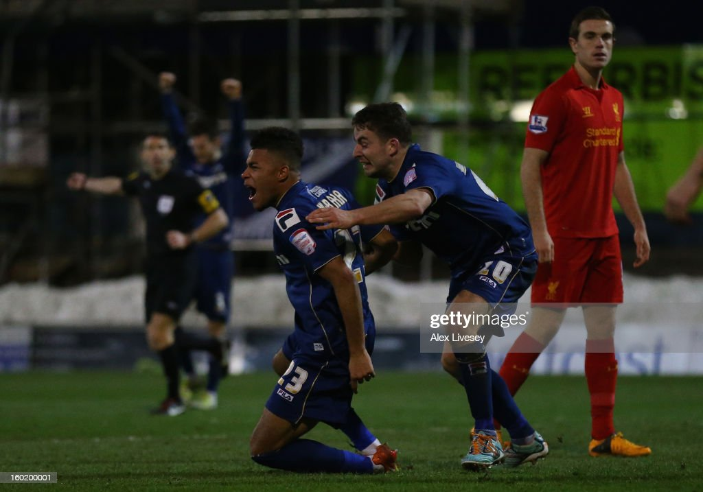 Reece Wabara of Oldham Athletic celebrates scoring his team's third goal with team-mate <a gi-track='captionPersonalityLinkClicked' href=/galleries/search?phrase=Jose+Baxter&family=editorial&specificpeople=5015103 ng-click='$event.stopPropagation()'>Jose Baxter</a> (r) during the FA Cup with Budweiser Fourth Round match between Oldham Athletic and Liverpool at Boundary Park on January 27, 2013 in Oldham, England.