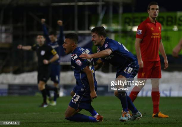 Reece Wabara of Oldham Athletic celebrates scoring his team's third goal with teammate Jose Baxter during the FA Cup with Budweiser Fourth Round...