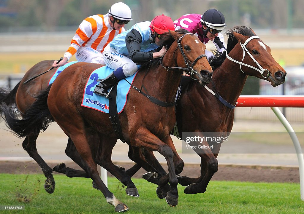 Reece Wheeler riding She Can Skate (inside) defeats Thomas Sadler riding Octavia in the Simpson Construction Handicap during Melbourne Racing at Moonee Valley Racecourse on June 29, 2013 in Melbourne, Australia.