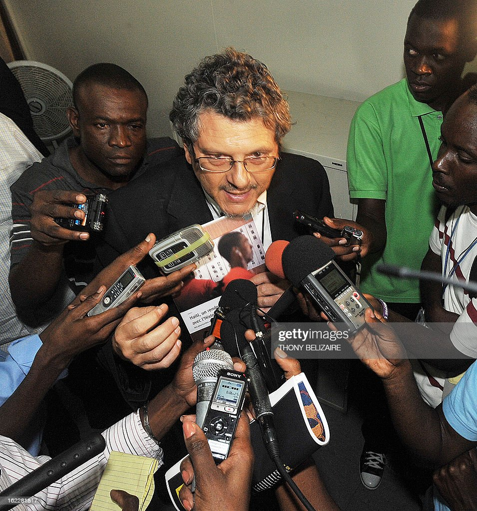 Reed Brody from Human Rights Watch speaks to the media on February 21, 2013 in Port-au Prince. Haitian justices ordered for the first time on Thursday for former Haitian dictator Jean-Claude Duvalier, 'Baby Doc,' to appear for a hearing, a decision hailed as a victory for the victims of his former dictatorship. Brody welcomed the decision. AFP PHOTO/ Thony BELIZAIRE