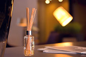 Reed diffuser detail in high end luxury room.