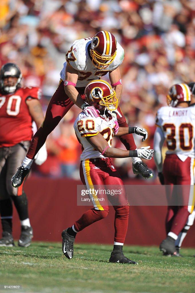 Reed Doughty of the Washington Redskins celebrates a touchdown with Justin Tryon against the Tampa Bay Buccaneers at FedExField on October 4 2009 in...