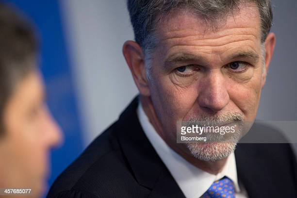 Reed Hastings chairman president and chief executive officer of Netflix Inc listens to a question during a Broadcasting Board of Governors panel...