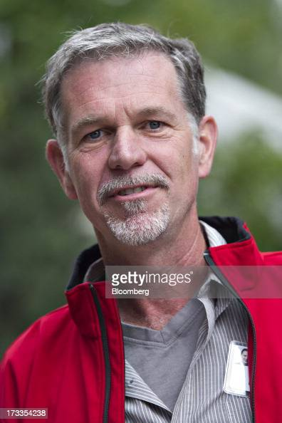 Reed Hastings president and chief executive officer of Netflix Inc walks outside during the Allen Co Media and Technology Conference in Sun Valley...