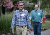 Reed Hastings president and chief executive officer of Netflix Inc left arrives for a morning session during the Allen Co Media and Technology...