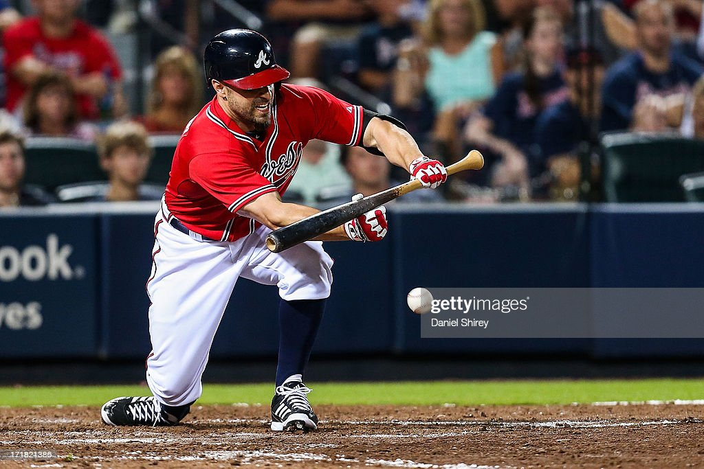 <a gi-track='captionPersonalityLinkClicked' href=/galleries/search?phrase=Reed+Johnson&family=editorial&specificpeople=209105 ng-click='$event.stopPropagation()'>Reed Johnson</a> #7 of the Atlanta Braves hits an RBI bunt single on a squeeze play in the eighth inning against the Arizona Diamondbacks at Turner Field on June 28, 2013 in Atlanta, Georgia.