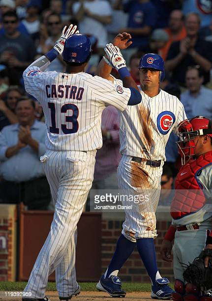 Reed Johnson of the Chicago Cubs greets teammate Starlin Castro after Castro hit a tworun home run in the 1st inning against the Philadelphia...