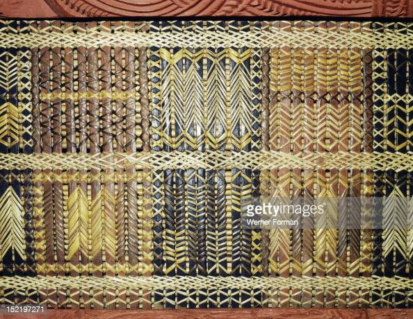 Reed latticework panels woven by women alternated with the carved wooden ancestor figures along - Woven wood wall panels ...