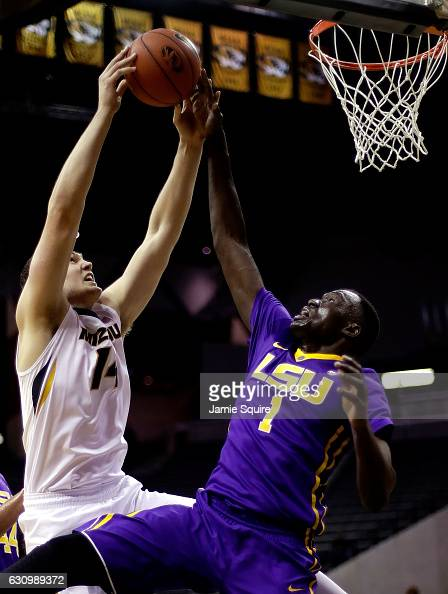 Reed Nikko of the Missouri Tigers and Duop Reath of the LSU Tigers battle for a rebound during the game at Mizzou Arena on January 4 2017 in Columbia...
