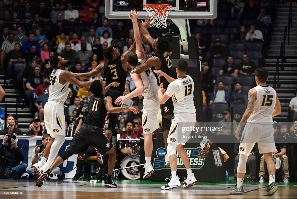 Reed Nikko #14 of the Missouri Tigers, Trent Forrest #3 of the Florida State Seminoles, and Mfiondu Kabengele #25 of the Florida State Seminoles fight for the rebound in the first round of the 2018 NCAA Men's Basketball Tournament held at Bridgestone Arena on March 16, 2018 in Nashville, Tennessee.