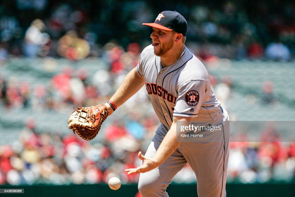 A.J. Reed #23 of the Houston Astros throws the ball to first base for a force out in the 2nd inning against the Los Angeles Angels at Angel Stadium of Anaheim on June 29, 2016 in Anaheim, California.