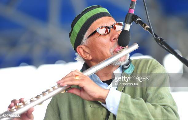 Reed player Charles Lloyd peforms with tabla player Zakir Hussain and drummer Eric Harland on 7 August 2011 on the main stage in Newport Rhode Island...