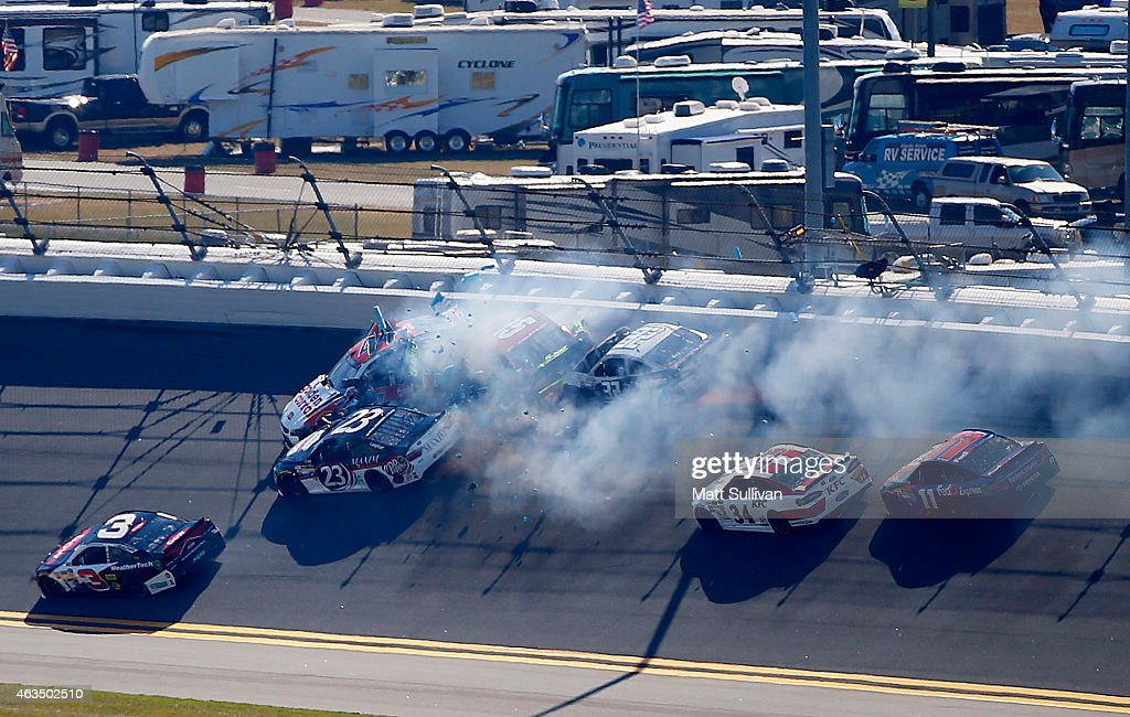<a gi-track='captionPersonalityLinkClicked' href=/galleries/search?phrase=Reed+Sorenson&family=editorial&specificpeople=208807 ng-click='$event.stopPropagation()'>Reed Sorenson</a>, driver of the #44 Golden Coral Chevrolet, and <a gi-track='captionPersonalityLinkClicked' href=/galleries/search?phrase=Clint+Bowyer&family=editorial&specificpeople=537951 ng-click='$event.stopPropagation()'>Clint Bowyer</a>, driver of the #15 5-hour ENERGY Toyota, <a gi-track='captionPersonalityLinkClicked' href=/galleries/search?phrase=Bobby+Labonte&family=editorial&specificpeople=203201 ng-click='$event.stopPropagation()'>Bobby Labonte</a>, driver of the #32 C&J Energy Services Ford, JJ Yeley, driver of the #23 MAXIM Fantasy App/Dr. Pepper Toyota, and <a gi-track='captionPersonalityLinkClicked' href=/galleries/search?phrase=Denny+Hamlin&family=editorial&specificpeople=504674 ng-click='$event.stopPropagation()'>Denny Hamlin</a>, driver of the #11 FedEx Express Toyota, are involved in an on track incident during qualifying for the 57th Annual Daytona 500 at Daytona International Speedway on February 15, 2015 in Daytona Beach, Florida.