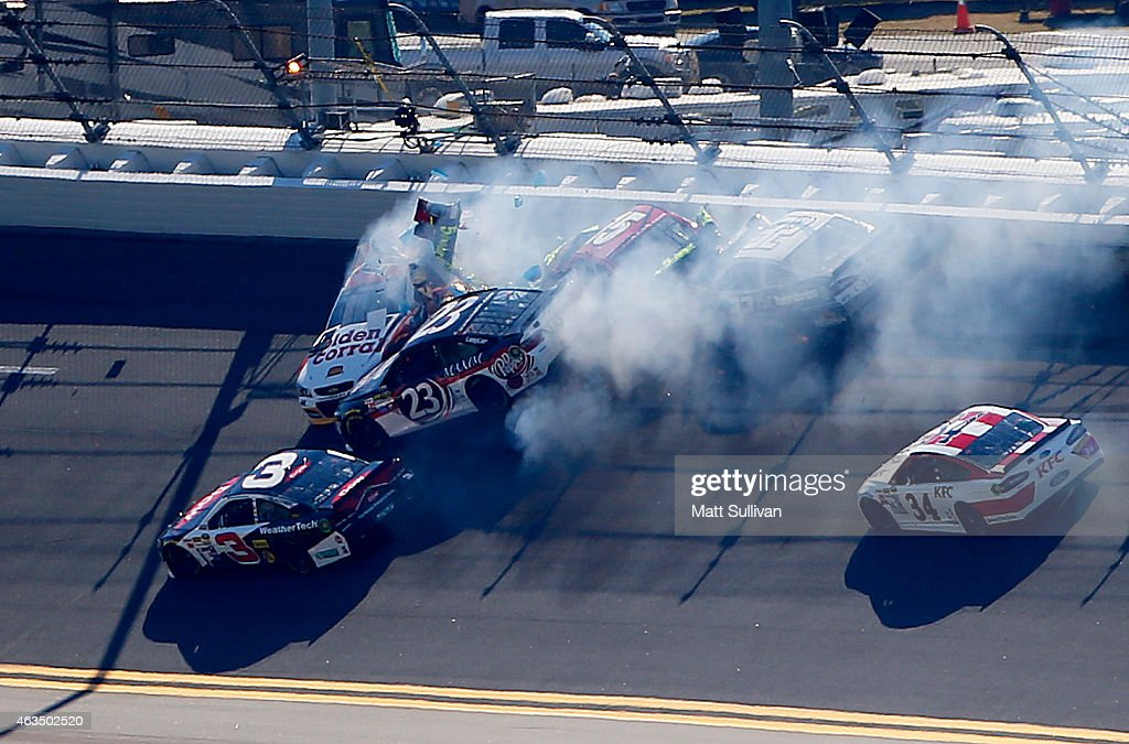 Reed Sorenson driver of the Golden Coral Chevrolet and Clint Bowyer driver of the 5hour ENERGY Toyota Bobby Labonte driver of the CJ Energy Services...