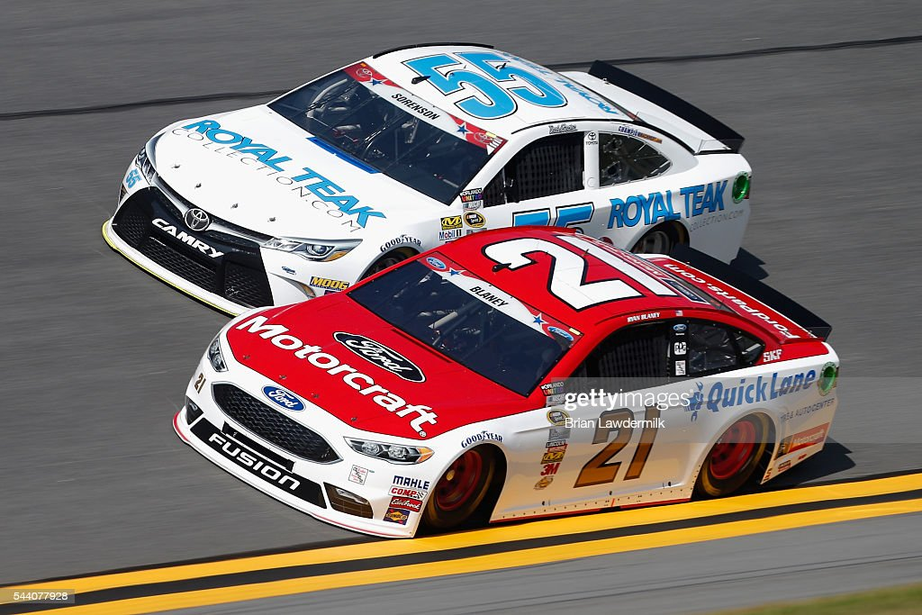 Reed Sorenson, driver of the #55 RoyalTeakCollection.com Toyota, and Ryan Blaney, driver of the #21 Motorcraft/Quick Lane Tire & Auto Center Ford, practice for the NASCAR Sprint Cup Series Coke Zero 400 at Daytona International Speedway on July 1, 2016 in Daytona Beach, Florida.