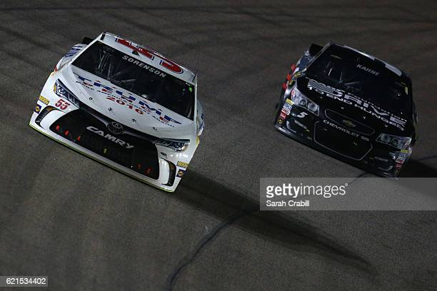 Reed Sorenson driver of the Trump Pence Toyota leads Kasey Kahne driver of the AARP Drive to End Hunger Chevrolet during the NASCAR Sprint Cup Series...