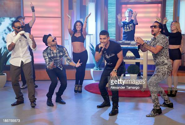Reek Sensato Wilmer Valderrama and Sky Blu are seen on the set of Despierta America at Univision Headquarters on October 24 2013 in Miami Florida