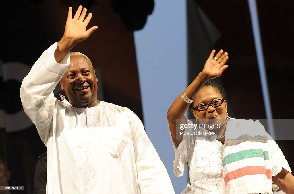 Reelected Ghanaian President John Dramani Mahama and his wife Lordina wave on December 10 2012 during a rally to accept his mandate at Kwame Nkrumah...