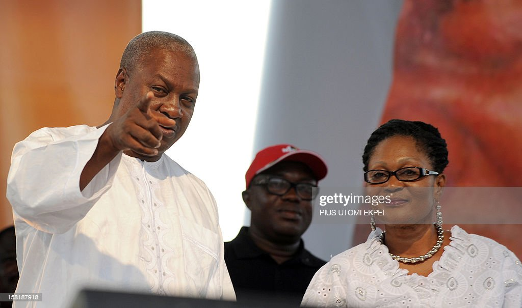 Reelected Ghanaian President John Dramani Mahama points out a guest to his wife Lordina wave on December 10 2012 during a rally to accept his mandate...