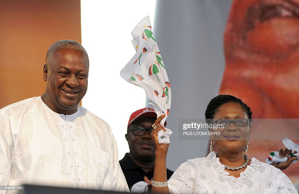 Reelected Ghanaian President John Dramani Mahama smiles as his wife Lordina waves a scarf on December 10 2012 during a rally to accept his mandate at...
