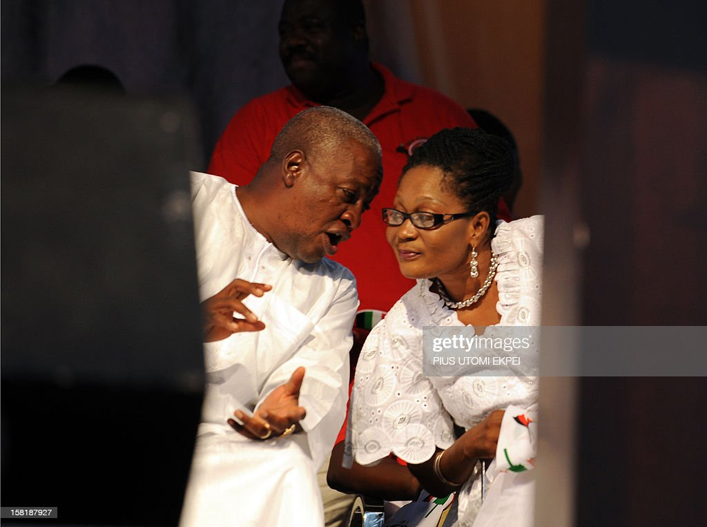 Reelected Ghanaian President John Dramani Mahama speaks with his wife Lordina on December 10 2012 during a rally to accept his mandate at Kwame...