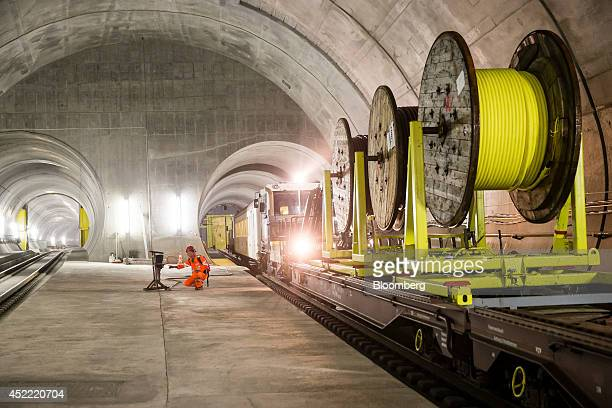 Reels of cable sit on a support freight train inside the east section of the Gotthard Base Tunnel in Faido Switzerland on Tuesday July 15 2014...