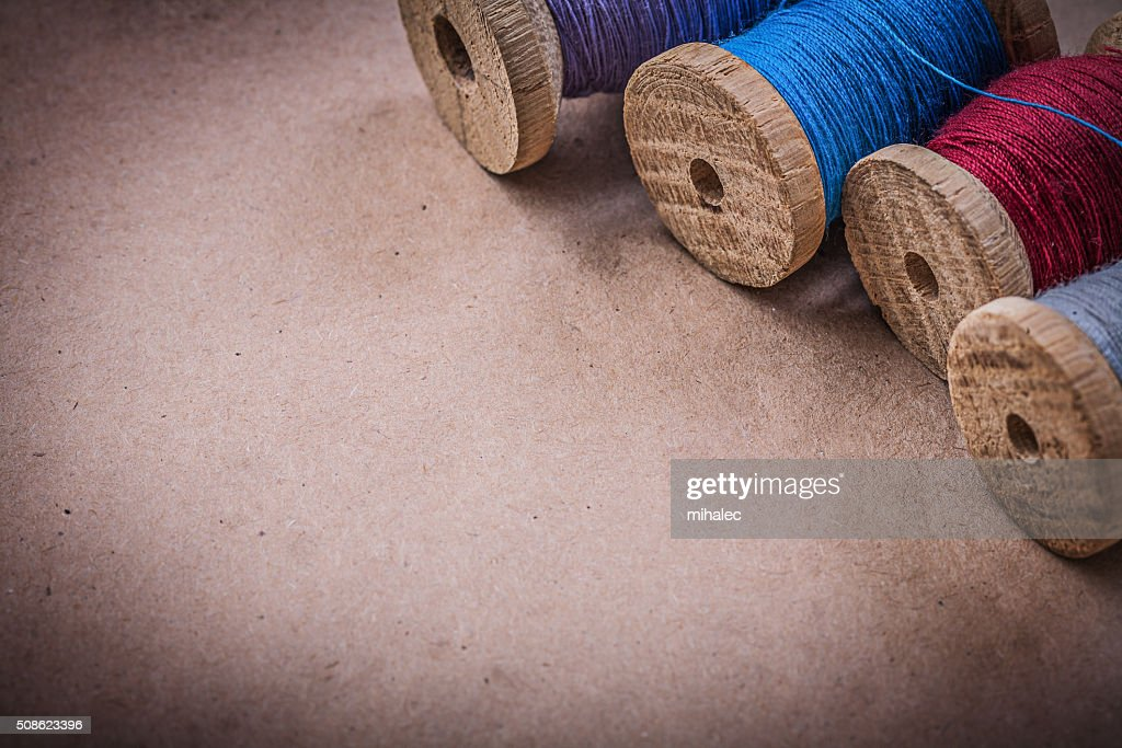 Reels of sewing threads on vintage background : Stock Photo