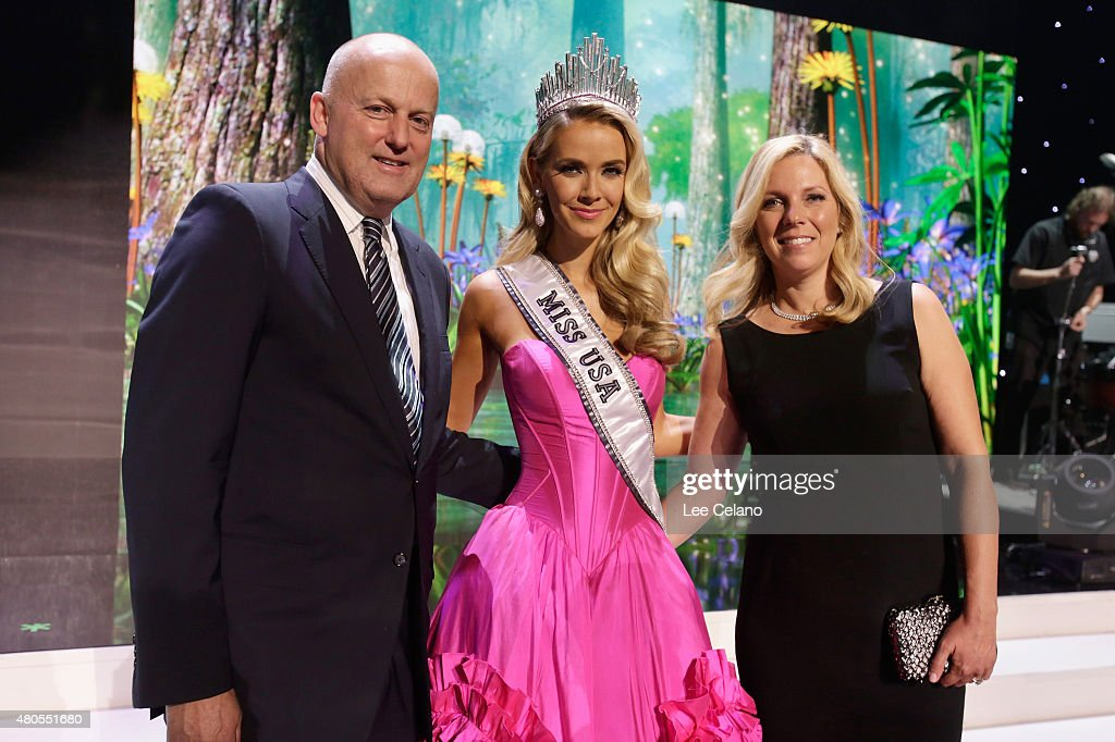 REELZChannel CEO Stan E. Hubbard, Miss USA Olivia Jordan of Oklahoma, and Jennifer Hubbard pose onstage at the 2015 Miss USA Pageant Only On ReelzChannel at The Baton Rouge River Center on July 12, 2015 in Baton Rouge, Louisiana.
