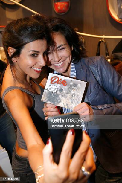 Reem Kherici and Sandra Zeitoun attend Reem Kherici signs her book 'Diva' at the Barbara Rihl Boutique on November 8 2017 in Paris France