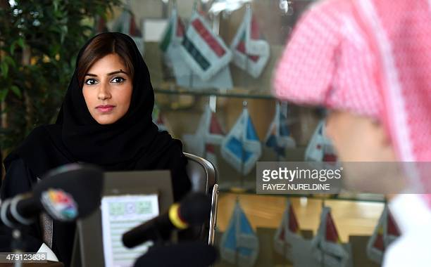 Reema Alwaleed bin Talal the daughter of Saudi Arabia's billionaire Prince Alwaleed bin Talal looks on as her father speaks during a press conference...